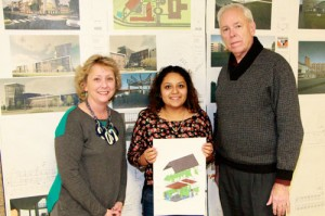 Pictured (l-r): YCAP Manager Peggy Quam, Architecture student Brenda Piliego-Geniz, and President Emeritus Dr. C. Ben Wright. Piliego-Geniz is holding a skin diagram she created in her studio class using SketchUp. The diagram shows what a house looks like when it is pulled apart and the materials are exposed.