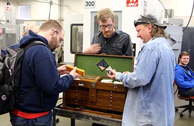 Students examining toolbox