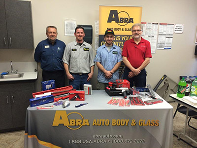 Anthony smiling after receiving tools from ABRA representatives