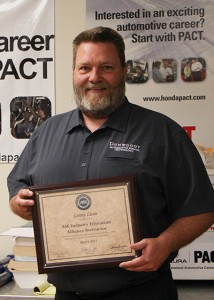Lonny holding award.