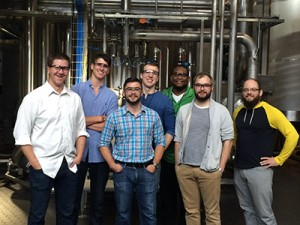 Electrical Construction Design & Management students smiling while on an electrical tour of Surly Brewing Company.