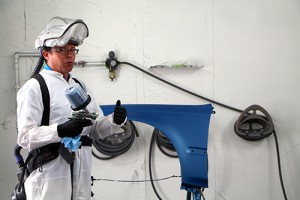 A photo of the waterborne paint expert talking at the event inside Dunwoody's waterborne spray paint booth