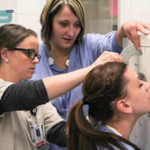 Clinical Instructor Amanda Barker works with Rad Tech students on site at North Memorial Hospital.