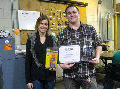 Molly Kujawa from Klein Tools honors Max Orman with the semi-annual Outstanding Graduate award.