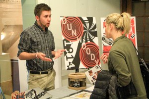 Second-year Design & Graphics Technology student talks to prospective employers at the annual Design & Graphics Intern Expo.