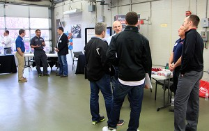 Photo of students talking at Auto Open House event