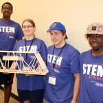 Photo of students with mini bridge