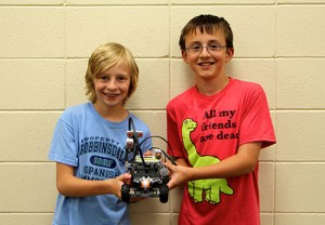 Photo of students with robot