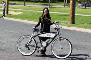 Stevie Nguyen with the bicycle she helped design and build with her group The Hacks as a capstone project for their degree.