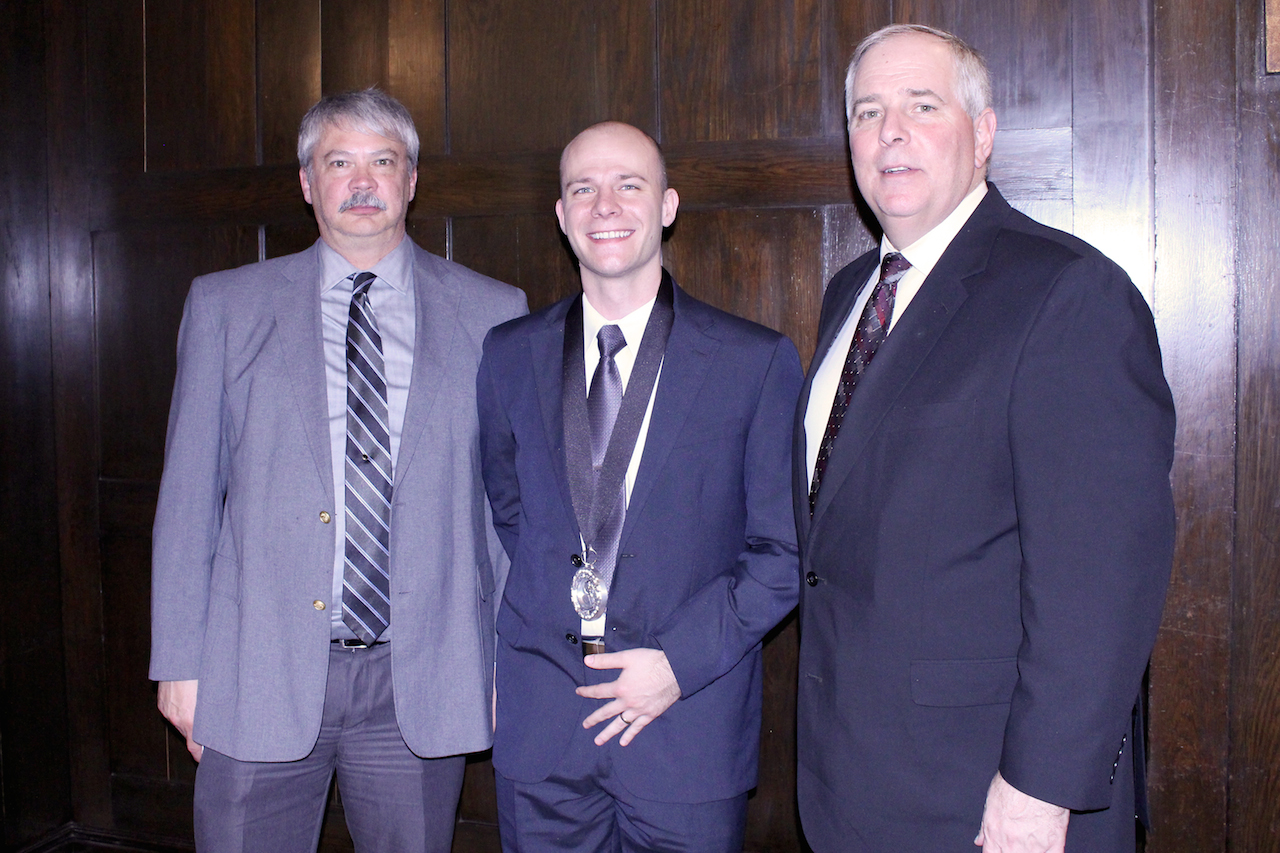 Pictured from left to right: Dean of Applied Management Mike White, Anthony Swanberg, College President Rich Wagner