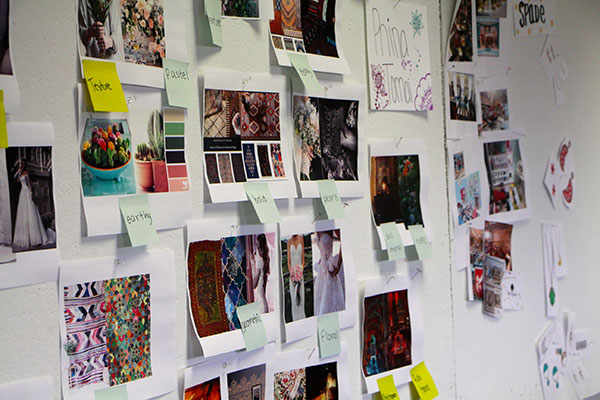 "Photo of a ""brainstorming wall"" where campers posted ideas, graphics, notes for design inspiration."