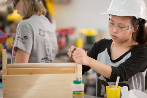 Photo of girl building in the construction lab
