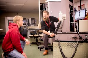 Mechanical Engineering Instructor Jonathan Aurand works with a student in the Metrology Lab.