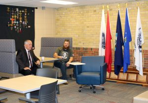 President Rich Wagner speaks to a veteran student during the Grand Opening of the new Center