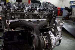 A close-up of an Audi vehicle's engine, recently donated to Dunwoody College