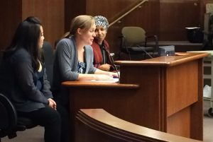 Hertel testifying in Minnesota State Legislature with MN Representative and Bill Author Ilhan Omar