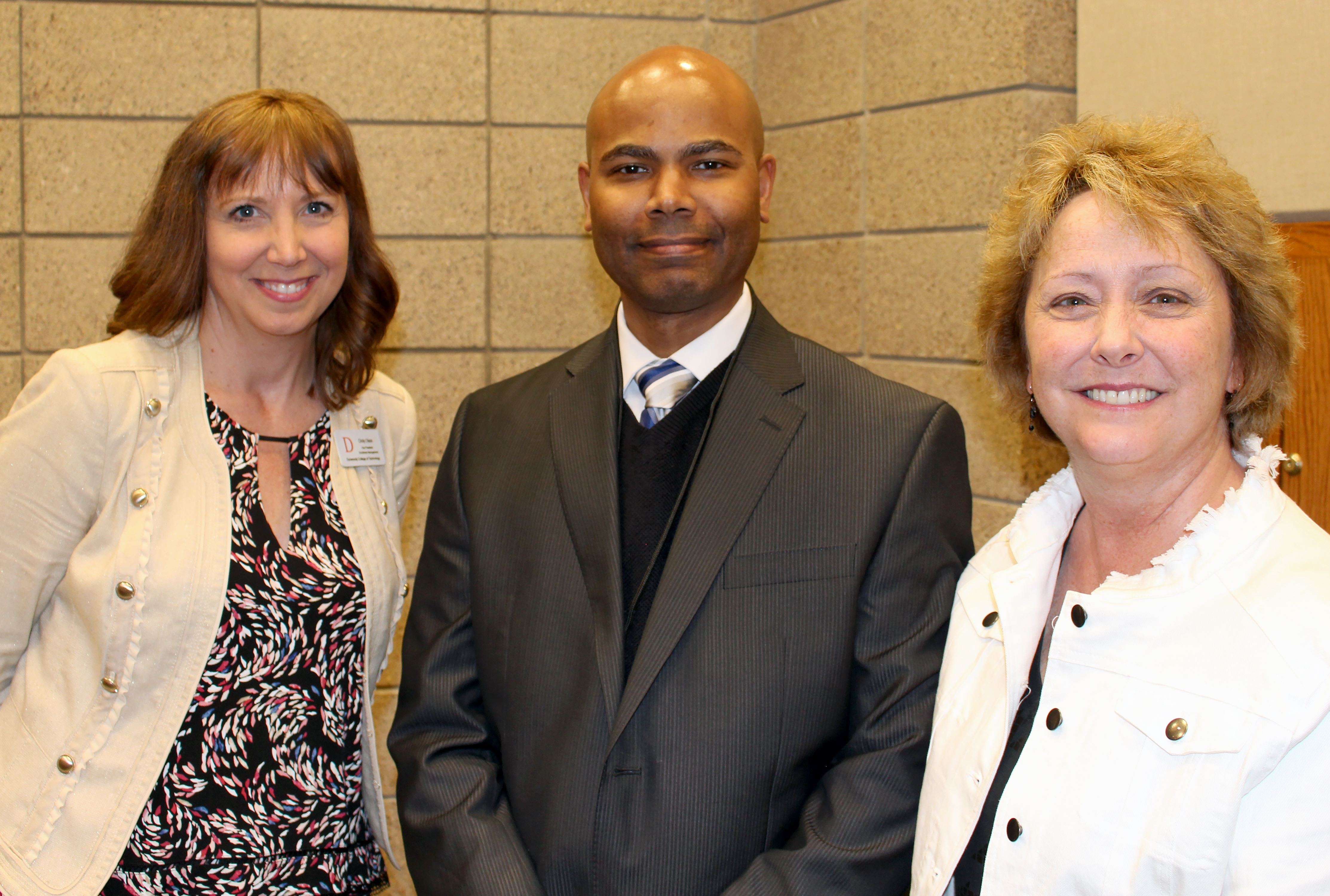From left to right: Vice President of Enrollment Management Cindy Olson, Principal of Ascension Catholic School Benito Matias, and Associate Director of Special Initiatives Peggy Quam
