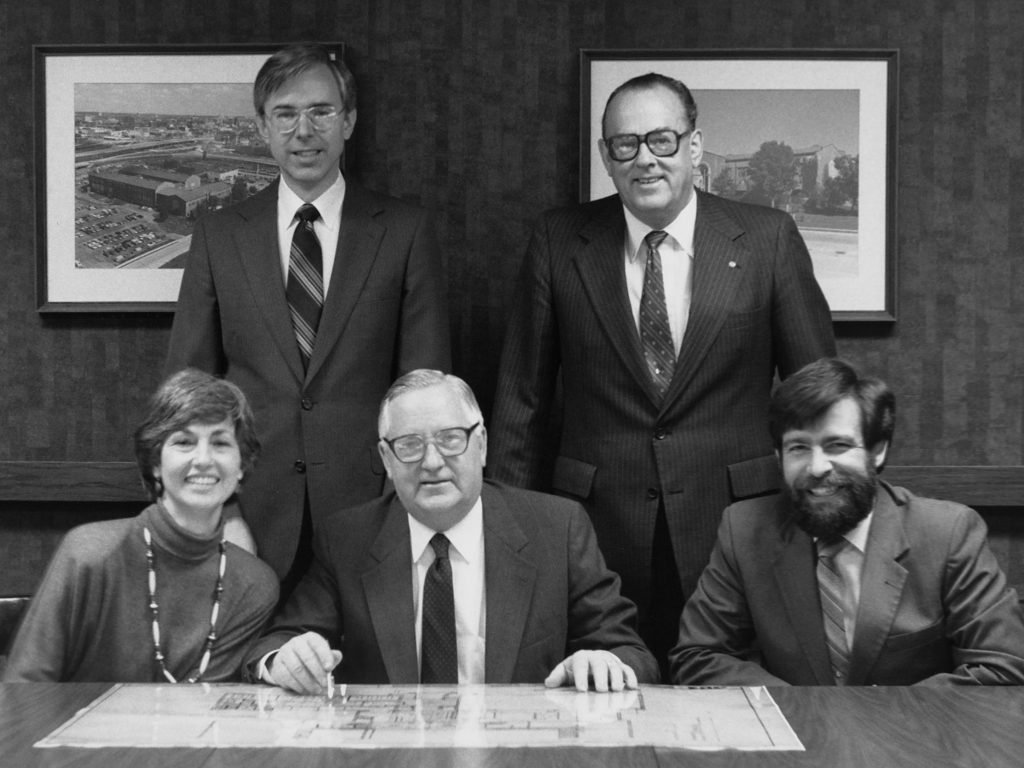 A photo of Warren Phillips and his team during his tenure as president