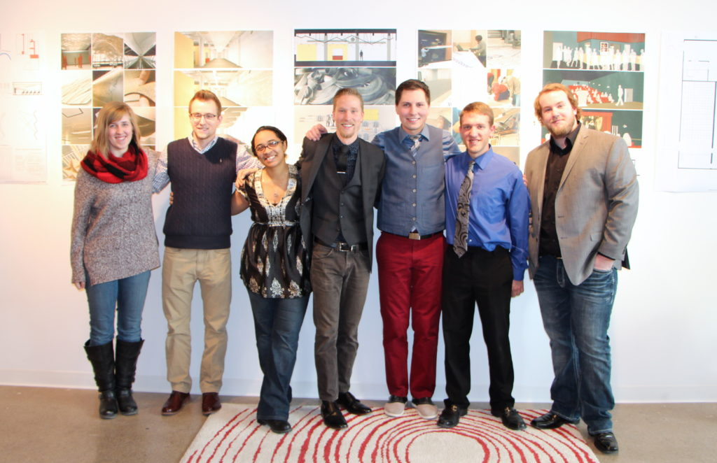 Several Dunwoody Architecture graduates at a final project presentation in 2015.