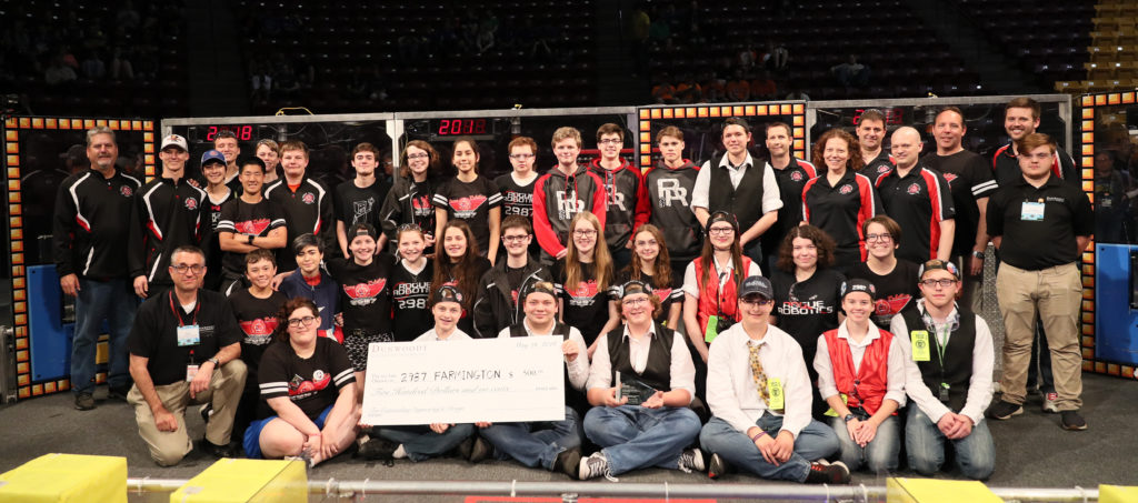 Photo of Dean E.J. Daigle with the the Farmington High School FiRST Robotics team