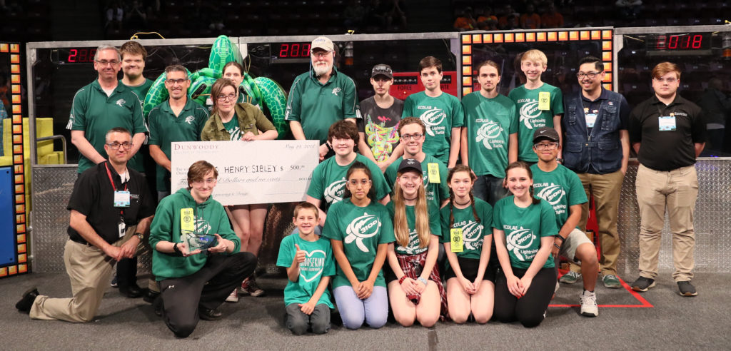 Photo of Dean E.J. Daigle with the the Henry Sibley High School FiRST Robotics team
