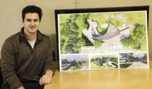 Student Austin Rastall with his one of his final boards for the Como Park project.