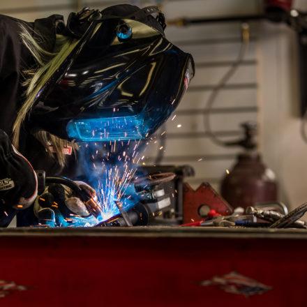 Alex Mars welds in her Lakeville shop.