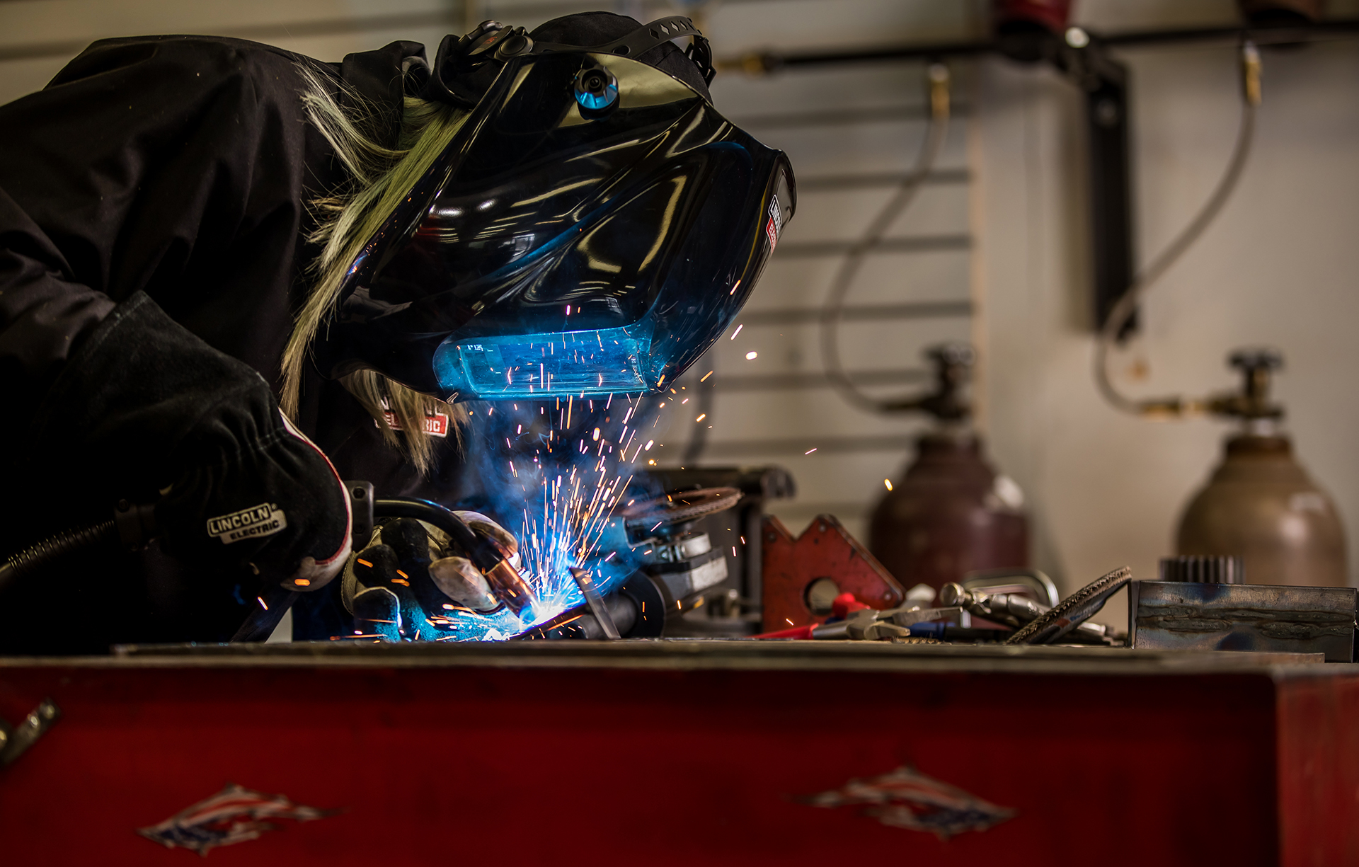 Alex Mars welds in her Lakeville shop.