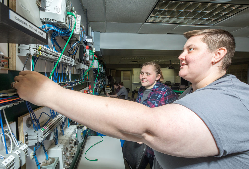 Ace High, right, works on a project in their Industrial Automation Lab.