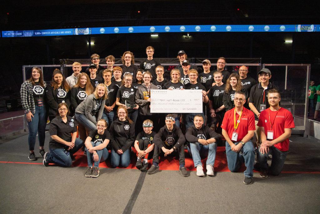 Photo of the Becker CIS team holding a big check