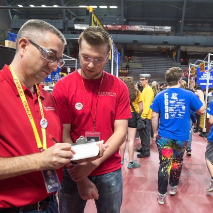 E.J. Daigle and Donald Posterick judge robot entries at First Robotics held at the University of Minnesota May 18, 2019. Dunwoody awards a trophy and a money to winners.