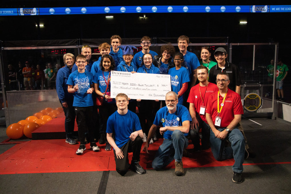 Photo of the Eagan High School team with a giant check