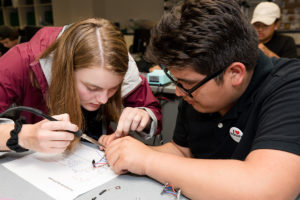 Mia Troska solders wires for a flashlight she made during her YCAP experience.
