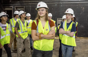 Mia Troska, front, tours a school being renovated by Kraus-Anderson while attending the Youth Careers Awareness Program summer camp. She is considering a degree in either Construction Management or Electrical Construction Design & Management.