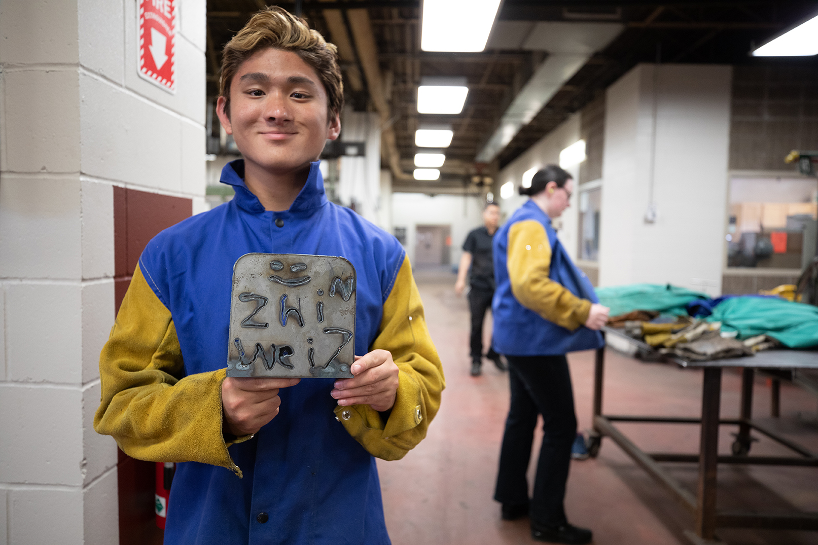 Zhiwei Blaubach shows off his welding creation that he made during a YCAP session.