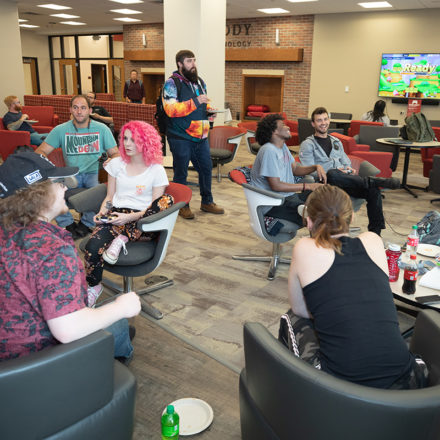 Students gather in the Fireside lounge to play video games during Student Affairs Game Night.