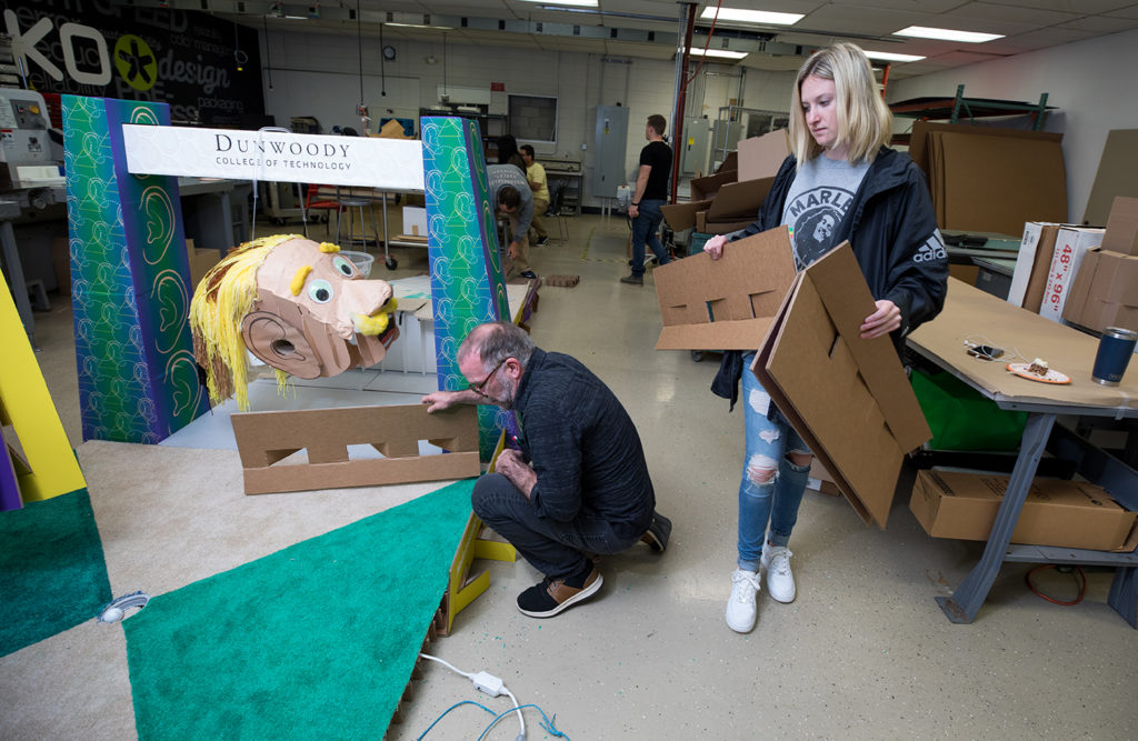 Students in the Advanced Structural Design class build a mini golf hole out of corrugated material for an entry at the Design Camp.