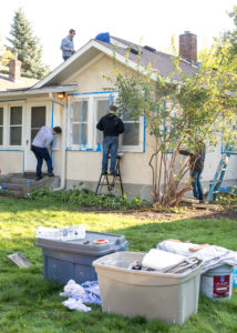 Industrial Engineering students paint the house of a homeowner in need.