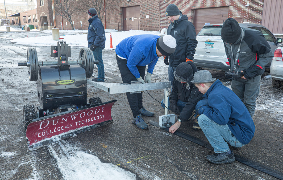 Snow Plow team members practice for the competition.