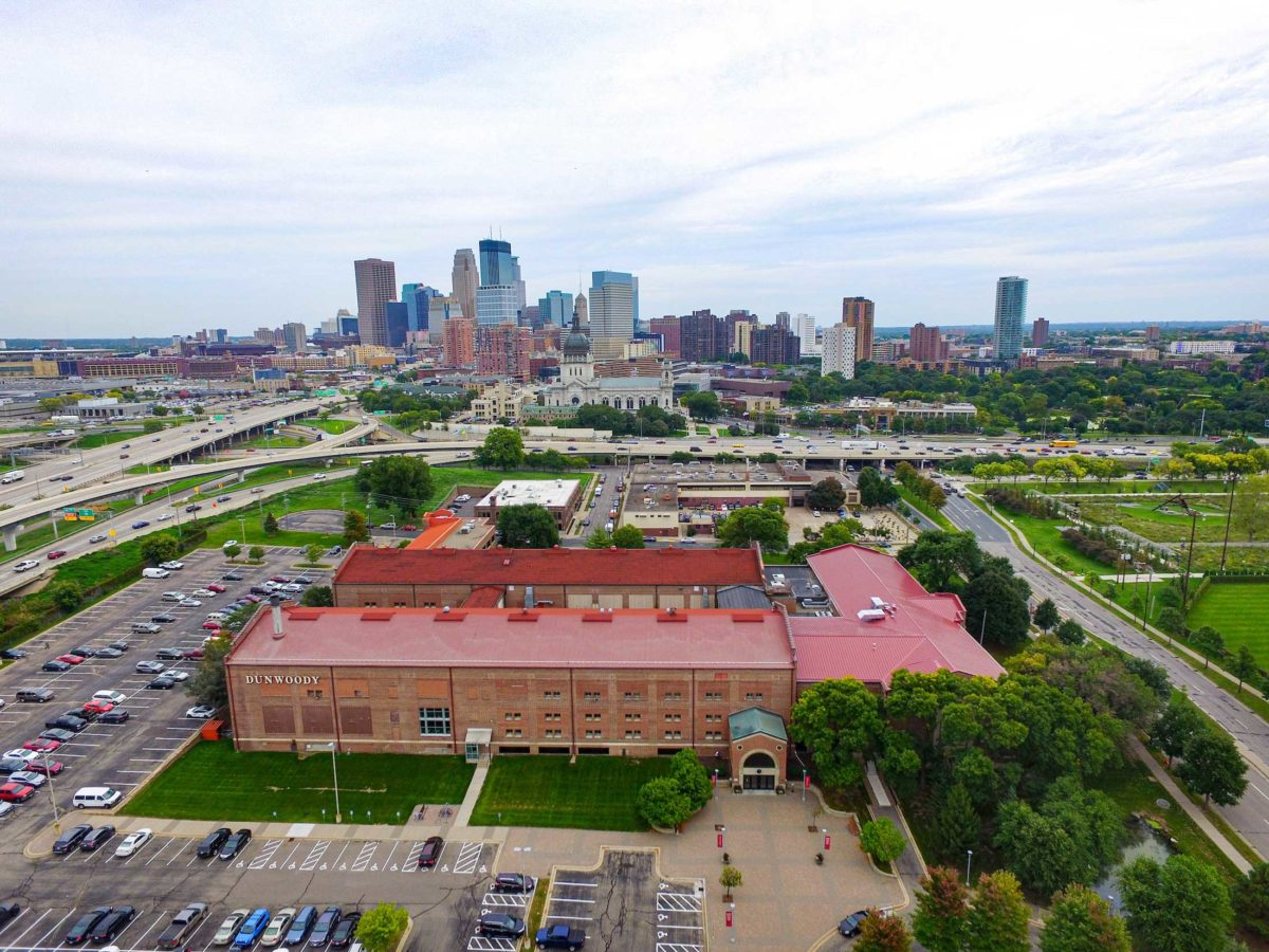 An aerial view of the Dunwoody College campus with downtown Minneapolis in the background