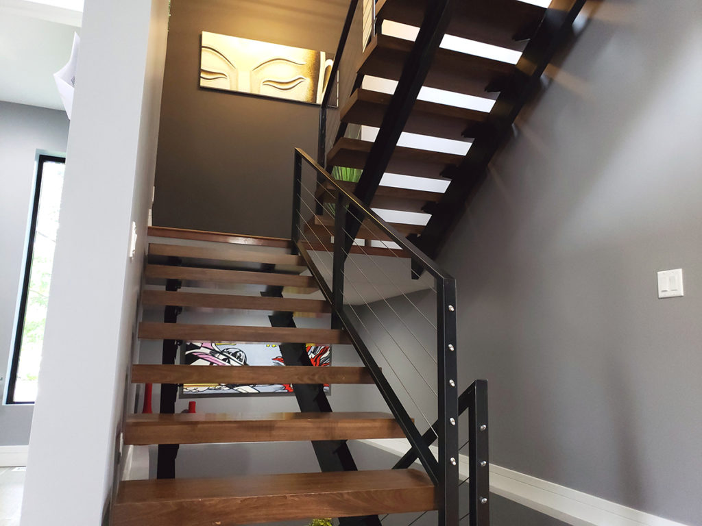 Metalwork on staircase designed and fabricated by Tommy Dao