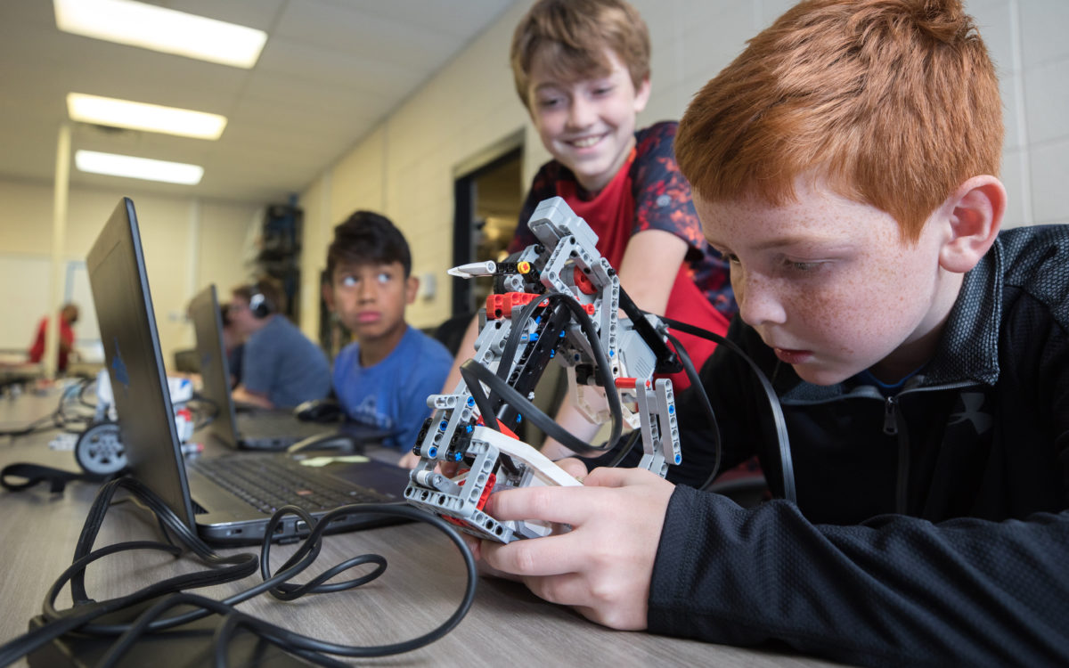 Camp attendees build LEGO robots in Arts N Crafts, Robotics & Computing Camp