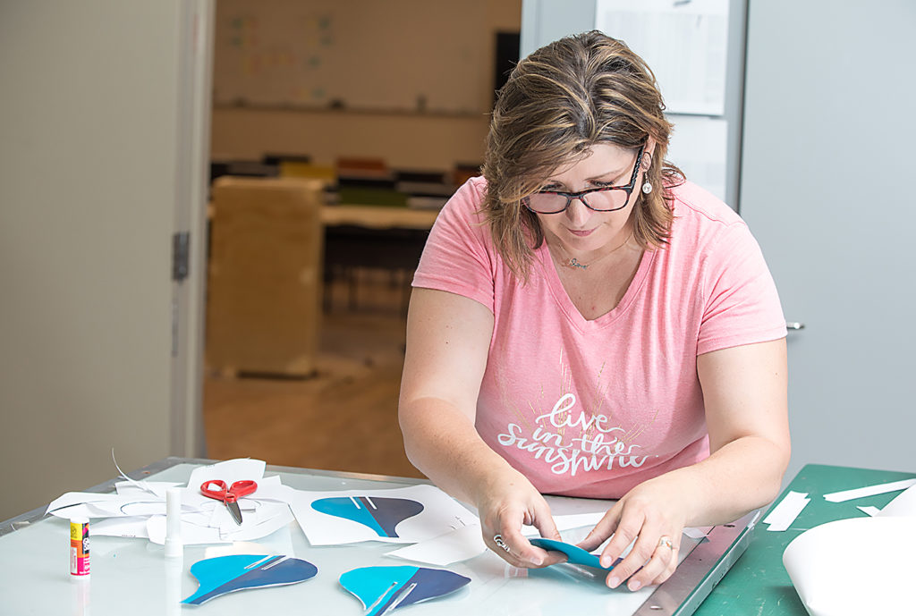 Michele Stenzel works on a design for a project that will be on display at the Minnesota State Fair.