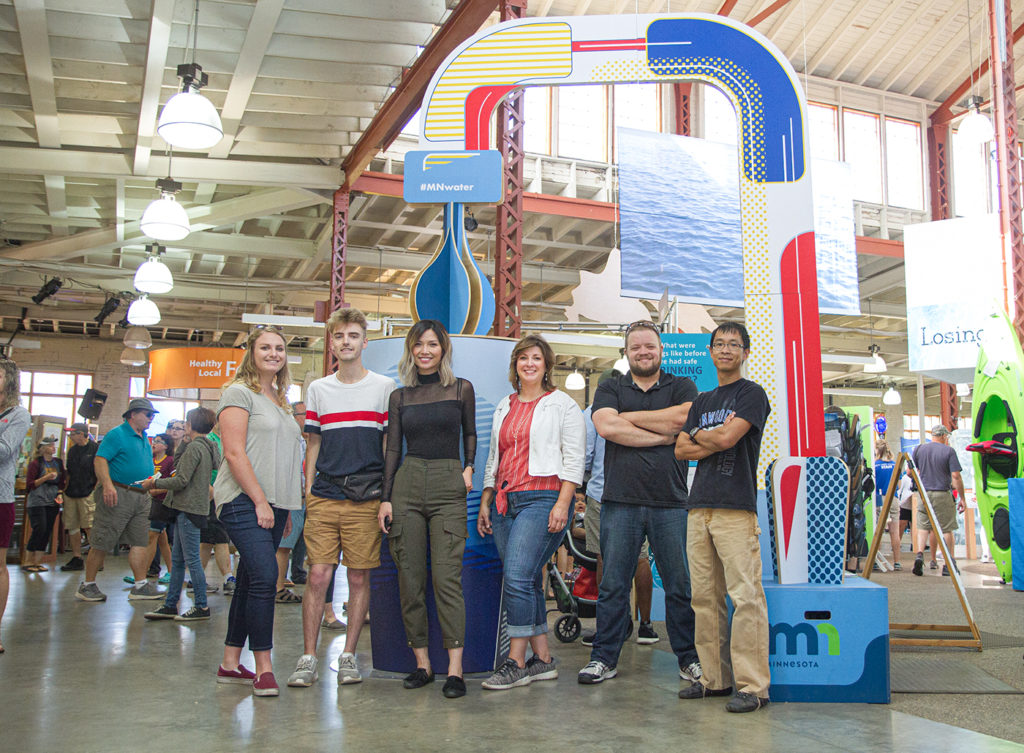 Michele Stenzel, fourth from left, with group she collaborated with to create the water project design on display at the Minnesota State Fair.