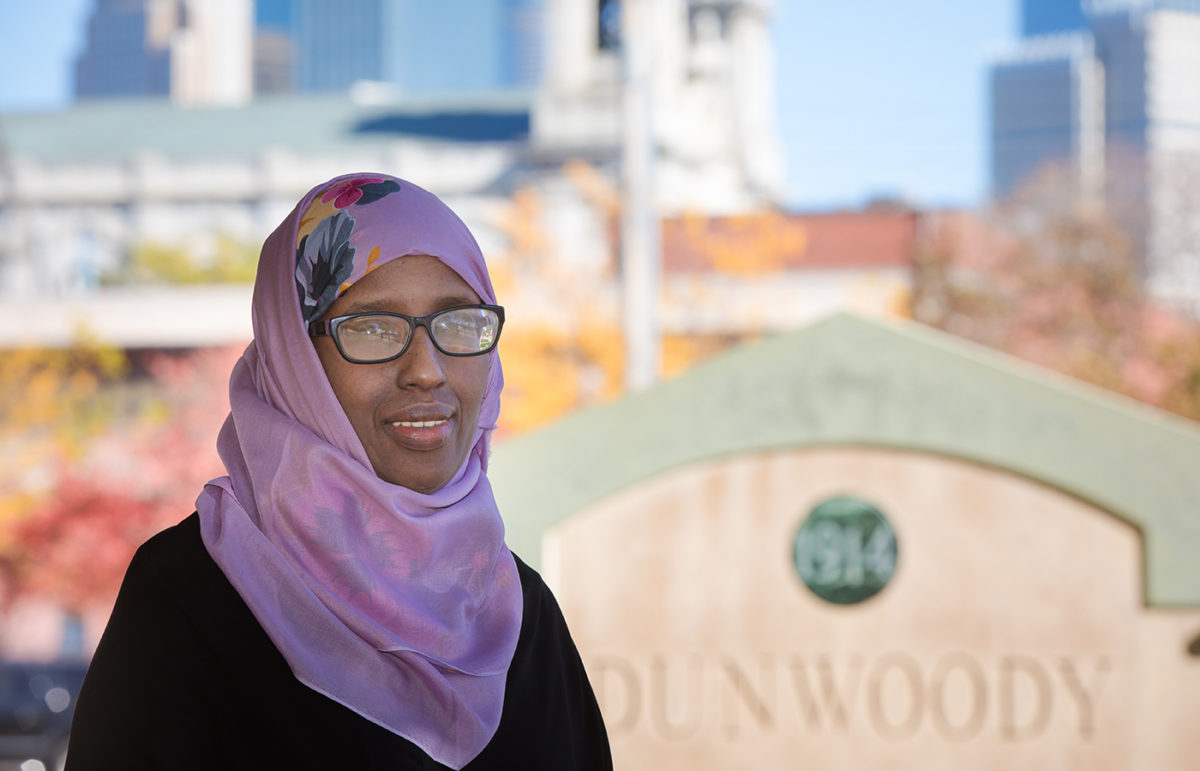 portrait of Faiza Duale with Minneapolis in the background