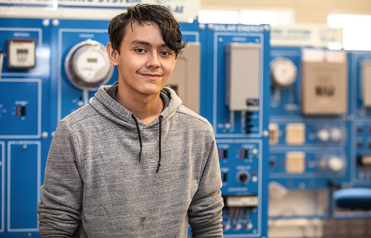 Alex Alvarado poses in the Electrical Lab