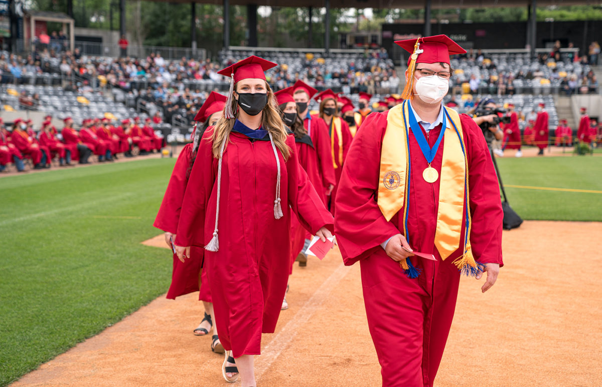 Returning graduates from the class of 2020 are recognized during the 2021 Commencement ceremony.