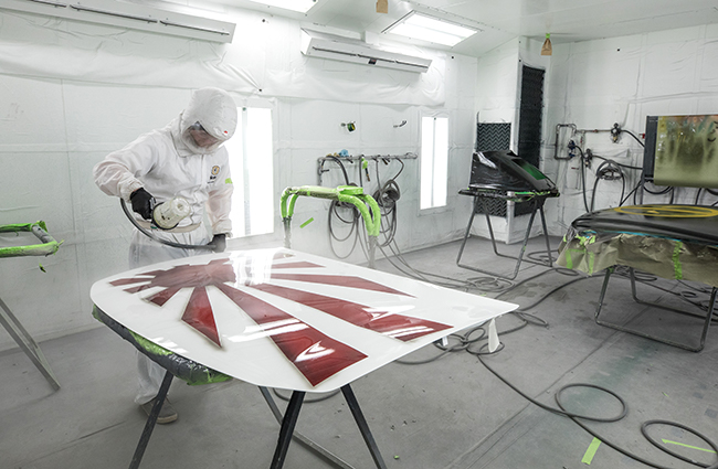 Auto Collision students using the paint booth.
