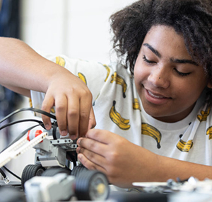 Photo of a student building a robot