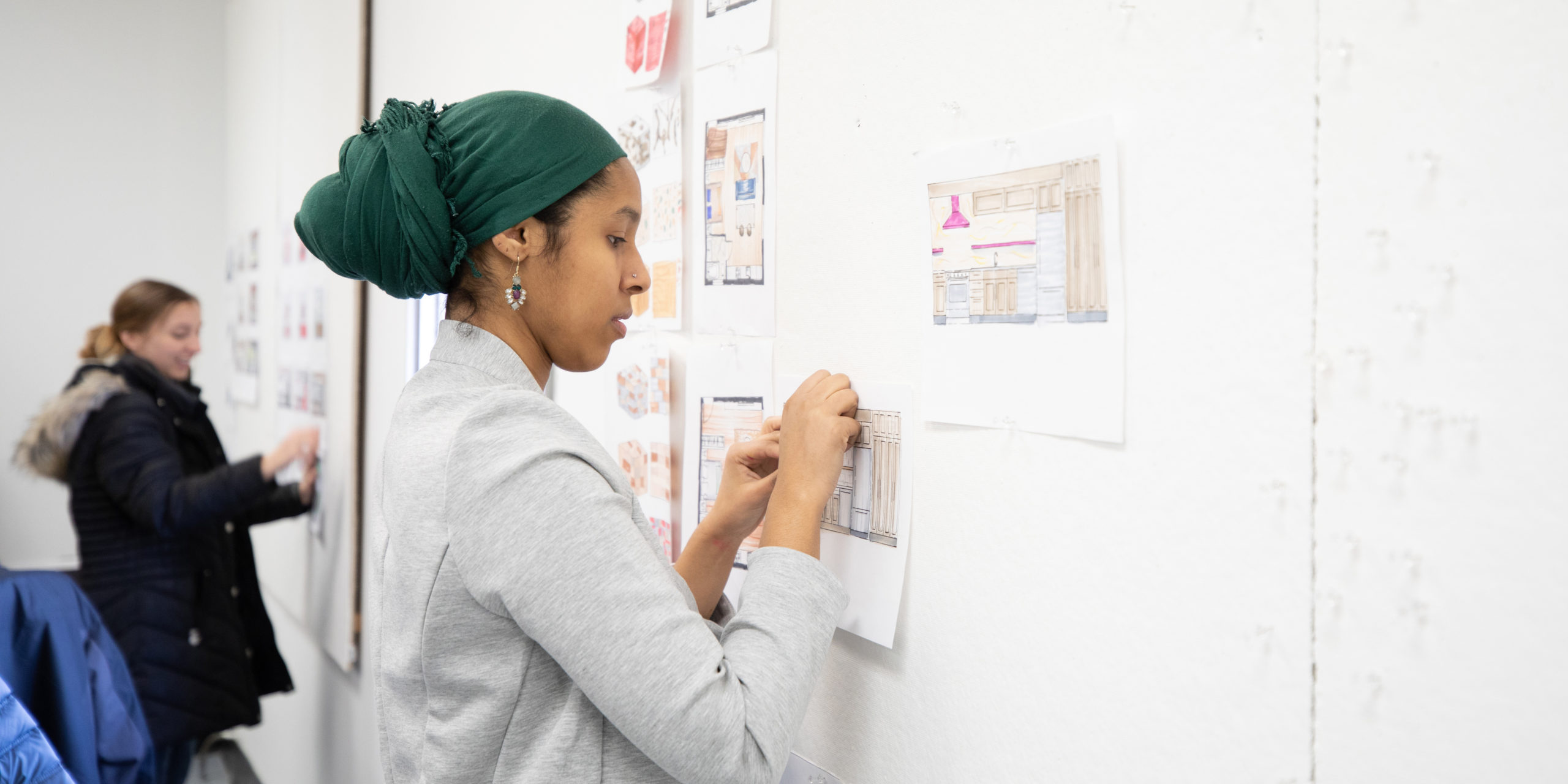 Student Sumeya Mohamed works on an Interior Design board